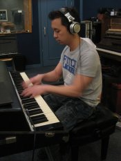 Tien playing Fender Rhodes at a recording session